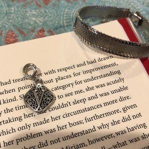 Silver toned Monet bracelet and V pennant